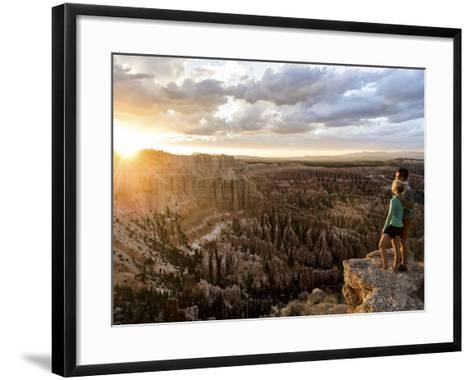 A Couple at Sunset in Bryce Canyon National Park, Utah, in the Summer Overlooking the Canyon-Brandon Flint-Framed Art Print