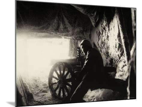 Italian Soldier in a Snow Cave on Monte Nero During World War I--Mounted Photographic Print