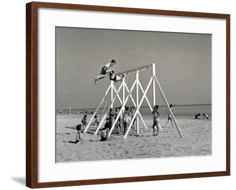 Group of Children Playing on a Swing on the Beach-A^ Villani-Framed Art Print