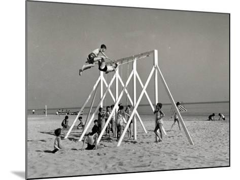 Group of Children Playing on a Swing on the Beach-A^ Villani-Mounted Photographic Print