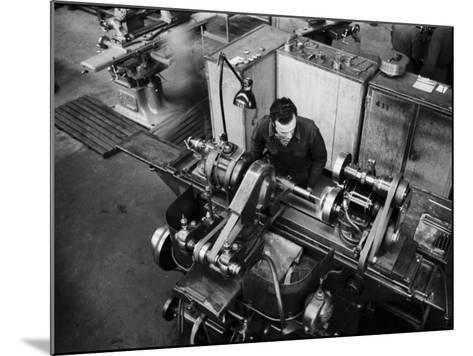 Worker Working at a Machine Inside the Innocenti Automobile Factory-A^ Villani-Mounted Photographic Print