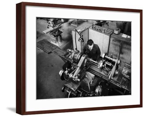 Worker Working at a Machine Inside the Innocenti Automobile Factory-A^ Villani-Framed Art Print