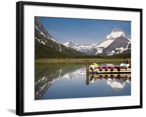 Colorful Canoes Line the Dock at Many Glacier Lodge on Swiftcurrent Lake During Sunrise-Brad Beck-Framed Art Print
