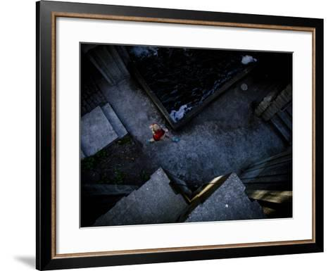 Lisa Eaton Goes for an Early Morning Run in Freeway Park - Seattle, Washington-Dan Holz-Framed Art Print