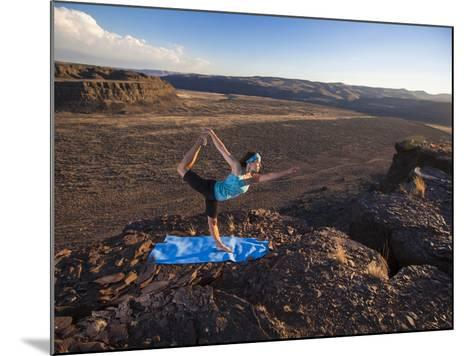 Dancer Pose During an Evening Outdoor Yoga Session at the Frenchman-Coulee in Central Washington.-Ben Herndon-Mounted Photographic Print