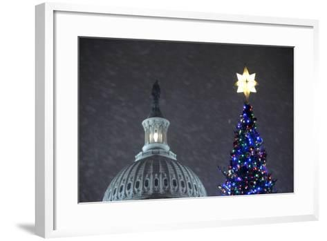 Snow Falls on the U.S. Capitol Christmas Tree During a Lighting Ceremony in Washington, DC, USA-Matthew Cavanaugh-Framed Art Print
