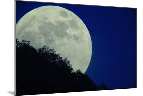 The Full Moon Rises Above Somoskoujfalu, 123 Kms Northeast of Budapest, Hungary-Peter Komka-Mounted Photographic Print