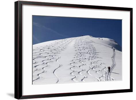 Touring Skiers Walk Up the Mountain Chapf Near the Village Grabs-Arno Balzarini-Framed Art Print