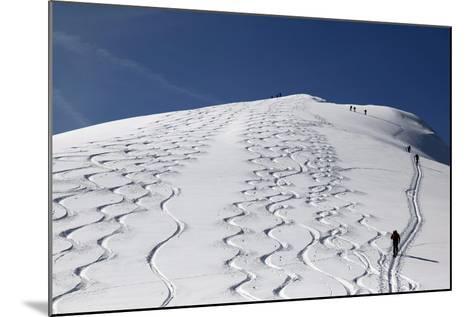 Touring Skiers Walk Up the Mountain Chapf Near the Village Grabs-Arno Balzarini-Mounted Photographic Print