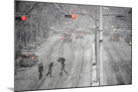 Pedestrians Cross a Large Avenue as Heavy Snow Falls in Tokyo-Franck Robichon-Mounted Photographic Print