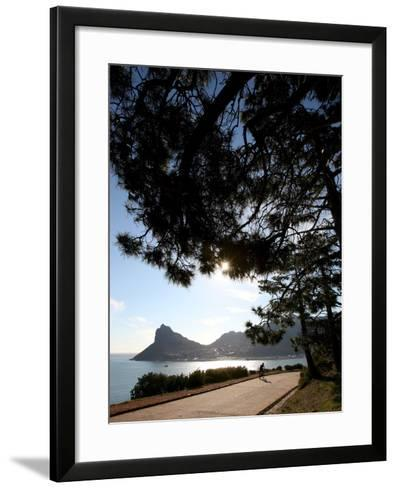 A Cyclist Rides Past the Sentinel Peak in Hout Bay Near Cape Town, South Africa-Jon Hrusa-Framed Art Print