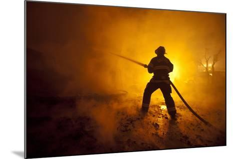 Fire Crews Work to Contain a Fire-Peter Dasilva-Mounted Photographic Print