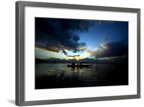 A Kashmiri Fisherman Rows His Boat on Dal Lake in Srinagar, the Summer Capital of Indian Kashmir-Farooq Khan-Framed Art Print