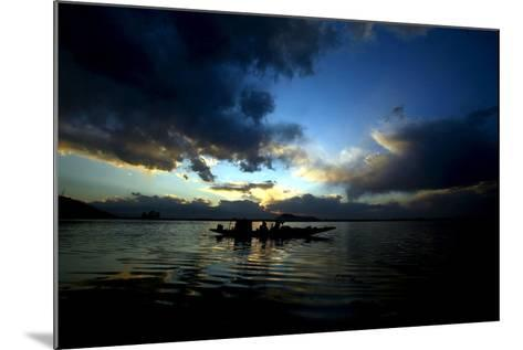 A Kashmiri Fisherman Rows His Boat on Dal Lake in Srinagar, the Summer Capital of Indian Kashmir-Farooq Khan-Mounted Photographic Print