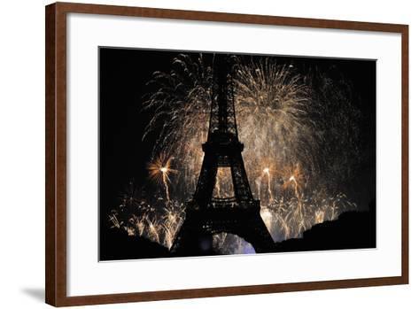 Fireworks Illuminate the Sky at the Eiffel Tower in Paris-Yoan Valat-Framed Art Print