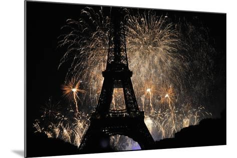Fireworks Illuminate the Sky at the Eiffel Tower in Paris-Yoan Valat-Mounted Photographic Print