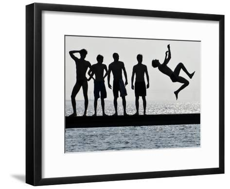 Boys Jumps into the Water on the First Sunny Spring Day in Malmo-Johan Nilsson-Framed Art Print