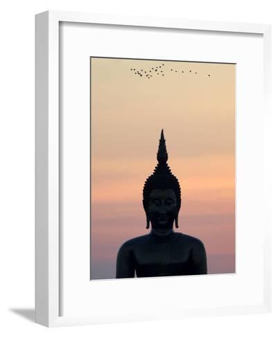 Birds Fly Past the Head of a Giant Buddha at Wat Muang-Barbara Walton-Framed Art Print
