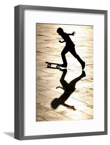 A Skateboarder Takes Advantage of a Sunny and Warm Day-Andrzej Grygiel-Framed Art Print