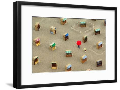Two Strollers Walk with Umbrellas Between Beach Chairs at the Beach of Travemuende-Wolfgang Langenstrassen-Framed Art Print