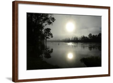 Early Morning Sun Rises Through the Fog over the Swollen Brisbane River-Dan Peled-Framed Art Print