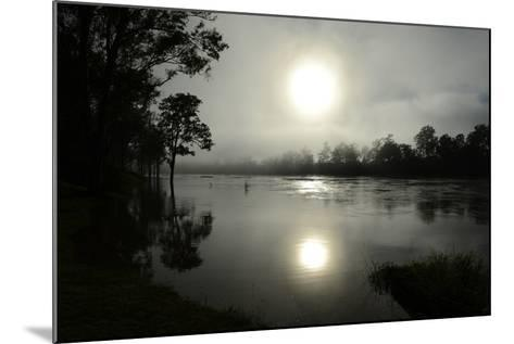 Early Morning Sun Rises Through the Fog over the Swollen Brisbane River-Dan Peled-Mounted Photographic Print