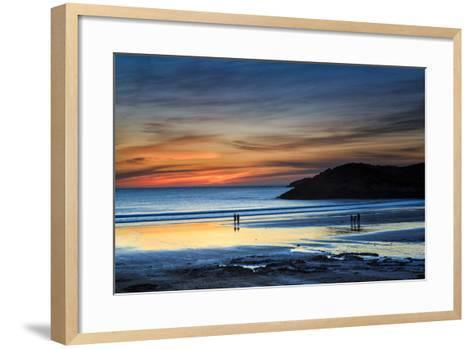 Beach Goers Enjoy the Last Rays of Sunlight at White Sands Beach in St. Davids, Wales-Frances Gallogly-Framed Art Print