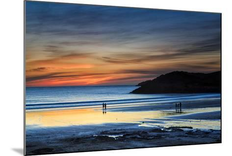 Beach Goers Enjoy the Last Rays of Sunlight at White Sands Beach in St. Davids, Wales-Frances Gallogly-Mounted Photographic Print
