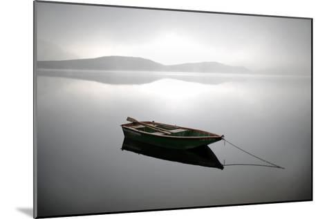 A Row Boat Floats on the Banks of Foggy Edersee Lake Near Waldeck, Central Germany-Uwe Zucchi-Mounted Photographic Print