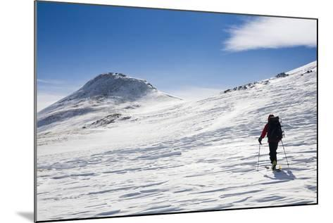A Skier Travels Near Ptarmigan Pass in the Vail Pass Winter Recreation Area, Colorado-Sergio Ballivian-Mounted Photographic Print