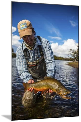 A Male Fly Fishing Guide Holds a Beautiful Male Brook Trout-Matt Jones-Mounted Photographic Print
