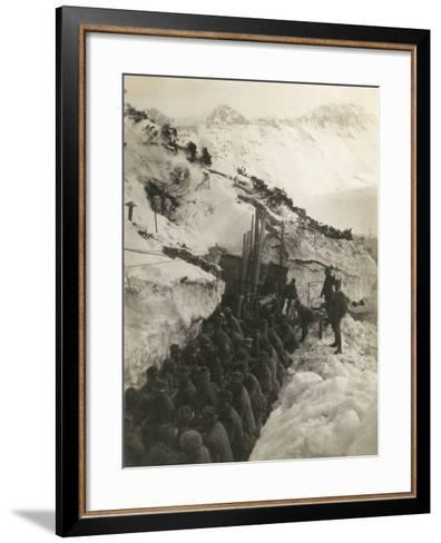 World War I: Soldiers in a Trench in the Snow Pulling a Gun--Framed Art Print