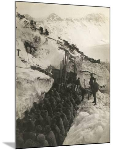 World War I: Soldiers in a Trench in the Snow Pulling a Gun--Mounted Photographic Print