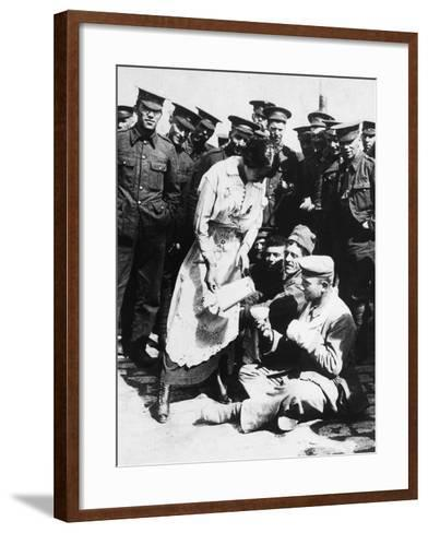 The Images Shows a French Lady Who Assists Some Wounded German Prisoners, Sitting on the Ground--Framed Art Print