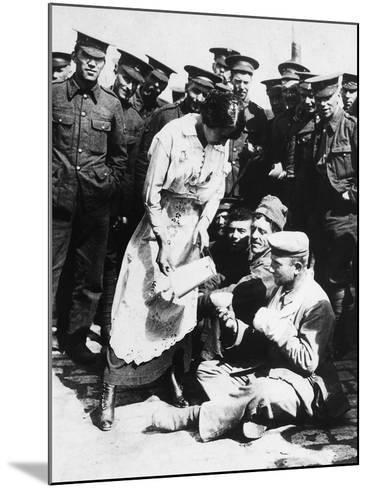 The Images Shows a French Lady Who Assists Some Wounded German Prisoners, Sitting on the Ground--Mounted Photographic Print