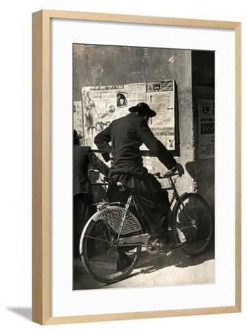A Priest on a Bicycle Reading Wall Newspapers of the Popular Democratic Front-Luigi Leoni-Framed Art Print