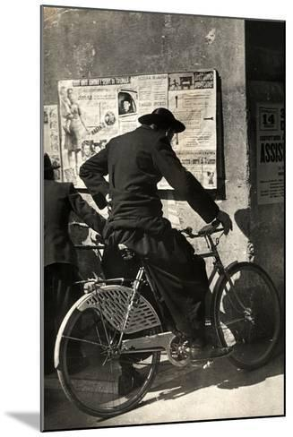 A Priest on a Bicycle Reading Wall Newspapers of the Popular Democratic Front-Luigi Leoni-Mounted Photographic Print