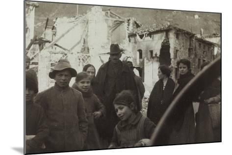 Residents of San Dona Di Piave. in the Background Buildings Destroyed by Bombing in World War I--Mounted Photographic Print