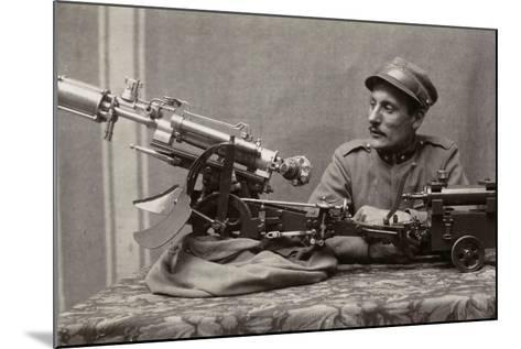 Soldier Near a Machine Gun--Mounted Photographic Print