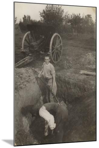 Young Boy Photographed While Digging a Trench in San Giorgio Di Nogaro During the First World War--Mounted Photographic Print
