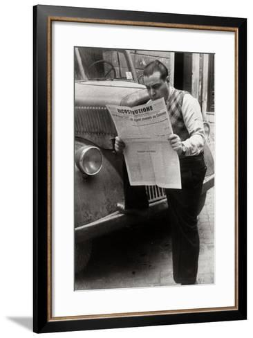 A Man Reads the Newspaper Ricostruzione with the Headline Allies Link Up Cologne-Luigi Leoni-Framed Art Print