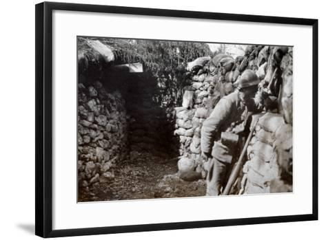 A Soldier in a Trench Scans the Surrounding Territory--Framed Art Print