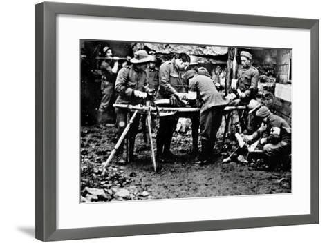 First Aid Given to a Wounded Soldier in the Front Lines During World War I--Framed Art Print