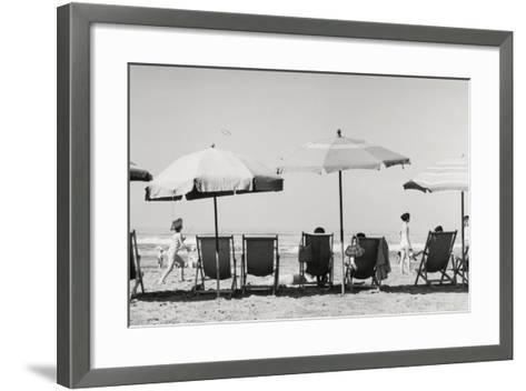 Row of Umbrellas and Chairs-Beach in Viareggio-Renzo Ferrini-Framed Art Print