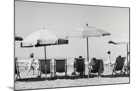 Row of Umbrellas and Chairs-Beach in Viareggio-Renzo Ferrini-Mounted Photographic Print