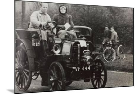 C.G.H. Dunham Driving a Race Car Vintage Renault--Mounted Photographic Print