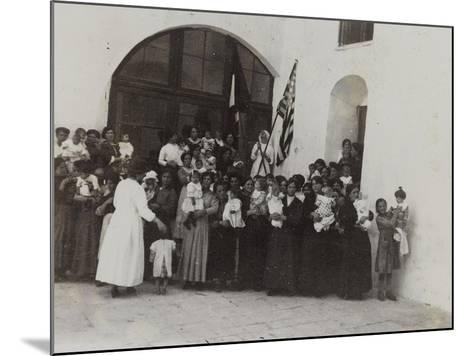 A Group of Women with Children Photographed in the Courtyard of a Convent--Mounted Photographic Print