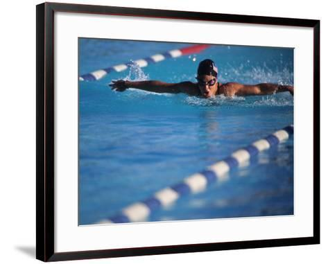 Female Swimmer Competing in a Butterfly Race--Framed Art Print