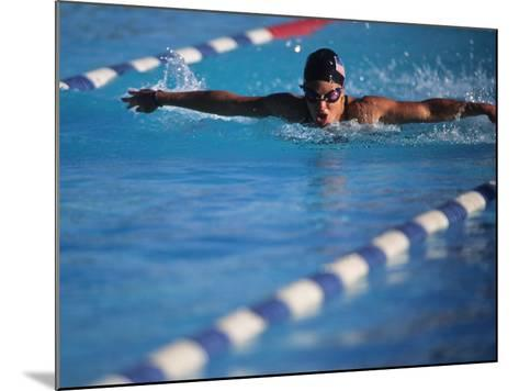 Female Swimmer Competing in a Butterfly Race--Mounted Photographic Print