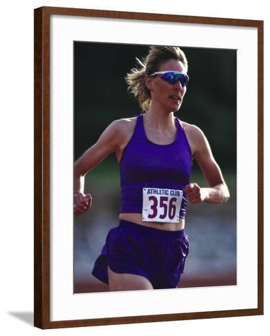 Female Runner Competing in a Track Race--Framed Art Print